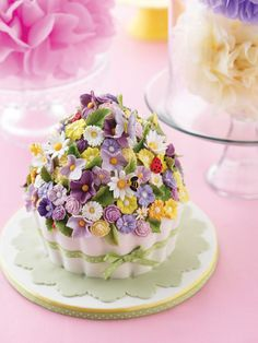 A Grand Treat.  Express your love of cupcakes with a grand version of this typically petite treat. For a fanciful twist, cover your super-sized cupcake with pretty sugar flowers and adorable critters.
