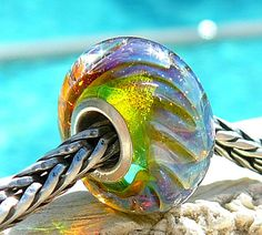 Rainbow Ripcurl Opal heavily encased in the best crystal clear glass! Description from etsy.com. I searched for this on bing.com/images