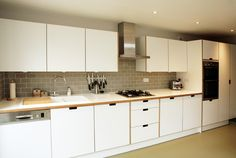 Formica Kitchen with birchply and formica worktops and grab handles
