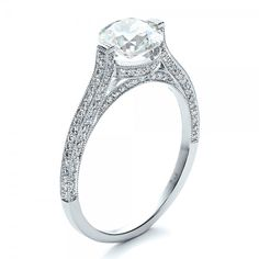 Check out this custom diamond engagement ring -- a round Old European brilliant cut diamond is tension set in a delicate pave set shank. My heart! Customize it here: https://www.josephjewelry.com/custom-diamond-engagement-ring-1443?page=5