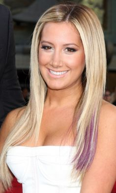 Ashley Tisdale long blonde hair with a 2013 purple peak a boo pops of color hair color