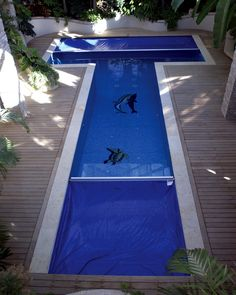 A double cover to accommodate the T-Shaped pool.