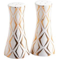 Give your tablescape an unexpected twist with these tapered salt and pepper shakers, showcasing geometric patterns in 24-karat gold. ...