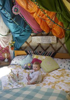 Yurt Life: Step into our bedroom! Family bed; retro mismatched bedding and lots of hanging colourful - ness :)
