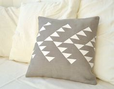 Grey linen pillow cover with geometric design in white Inspired by tribal patterns on Etsy, $34.78
