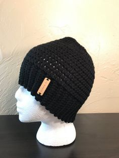Crochet beanie with a hole in the top so your ponytail or bun can stick out. Its perfect for sports or for those days you want to throw your hair up and still stay warm!  Color: black Size: womens Fits head circumference of 23 inches. Ready to ship!  Handmade by me in my smoke free and pet free home.