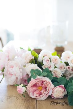 How to use faux flowers to decorate a table, centerpiece or mantel.