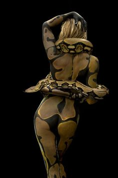 "Body Paint. Boa. (edit! ""Not a boa. She's painted like a ball python and wearing a tiger reticulated python."" Thanks, Tammy!)"