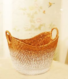 ombre basket Dip in a water bas paint. Let it dry a little bit. Invert and dip in water. (less each time). Use a brush to blend (wash away some of the paint)