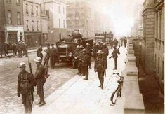 This photo depicts a scene from the Easter Rebellion, during April of 1916, when Irishmen attempted to declare their independence from British control. Description from awesomestories.com. I searched for this on bing.com/images