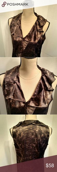 T Tahari blouse. T. Tahari elegant print blouse.  Cute design.. Front and back.  Stylish front. Sleeveless.  Unique neckline pattern.  Excellent condition.  Dominant chocolate brown color with lighter shades of shimmer.  Polyester blend.  Back is longer than front.  B102 Tahari Tops Blouses