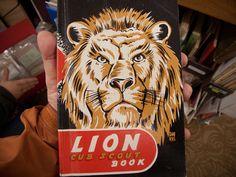 https://flic.kr/p/7YB8ir   Lion Cub Scout book.