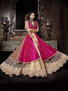 Breathtaking beige and pink net silk festival wear bridal lehenga choli. Having fabric net, silk and brocade. The appealing embroidery work a significant element of this attire. Comes with matching choli and dupatta. #mydesiwear #lehengacholi #bridalwearlehengacholi #silknet #partywearlehengacholi