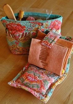 here is a handy little sewing needle case and bag that i made quite a while ago (using my parent's sewing machine - i really need to get one of my own!). i used some of my favorite oilily material...