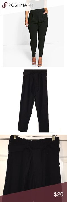 Boohoo curve pleat front trousers black Boohoo curve/ plus pleat front trouser in black! Only worn twice. Super cute day to night, office to party staple piece!  (Pants have belt loops and a tie for them, stock photo is the closest thing I could find the the original listing)  Make an offer or bundle to save! Everything must go!  Thanks for looking at my closet, everything I make on poshmark goes towards college! Happy poshing! 💕 Boohoo Plus Pants Trousers
