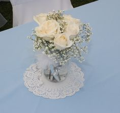Baptism Centerpiece - mason jar, white roses, baby's breath, tulle to wrap around the mason jar, small pompom made out of tulle. Boy Baptism Centerpieces, Communion Centerpieces, First Communion Decorations, First Communion Party, Baptism Decorations, Party Centerpieces, Baby Shower Decorations, Balloon Decorations, Baptism Reception