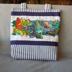 All natural eco-friendly everyday tote bag featuring detailed cross stitch panel, silk lining and side pocket by KindredClassics on Etsy Seat Covers For Chairs, Eco Friendly Bags, Needlepoint Kits, Green Stripes, Hand Stitching, Floral Design, Cross Stitch, Butterfly, Tapestry