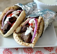 Beef Gyros with tomatoes and onion and drizzled it with an easy cucumber dressing made with greek yogurt.