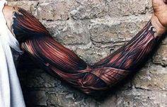 Full Sleeve Muscle Ripped Skin Tattoo On Man
