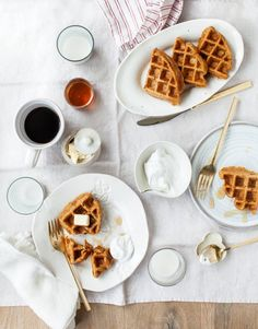 These 10-ingredient vegan waffles are easy to make and add a veggie kick to your breakfast! Great for weekend brunch, they're spiced with cinnamon for a carrot cake-like flavor. Leftovers freeze well. | Love and Lemons #veganbreakfast #brunch #carrots #carrotcake