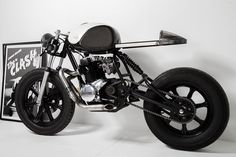 Yamaha XS400, stripped to the bare necessities, mono shock frame mod plus a vintage Yamaha gas tank equals one cool ride. :)