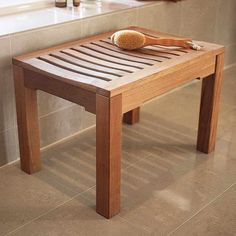 Clean teak shower bench with warm water and vinegar spray, then rinse. Water and baking soda for set in mildew.