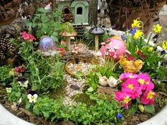 A very colorful fairy garden! via Blooms and Beasties