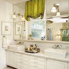 Hang more (or larger) mirrors. Betty's vanity mirrors extend up to the ceiling, making the room appear open and airy.Run shower tile all the way up to the ceiling. Your walls will look taller