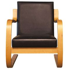 Mid Century Modern Alvar Aalto Birch Scroll Chair | From a unique collection of antique and modern lounge chairs at http://www.1stdibs.com/furniture/seating/lounge-chairs/