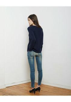 navy sweater, skinny jeans, black heels