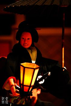 The light the light. from an object the puppet is holding.  Bunraku - Japanese traditional puppet show