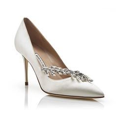 Manolo Blahnik - NADIRA  $1030.00  White satin pointy toe court shoes featuring an asymmetrical Swarovski crystal leaf embellishment and spin high heel. Upper: 100% silk satin. Sole: 100% cow leather. Lining: 100% kid leather. Heel measures 90mm. Italian sizing. Made in Italy.   - https://www.manoloblahnik.com/us/products/nadira-11280339