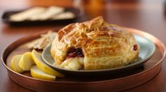 Crimson cranberries provide a little tartness to mellow Brie cheese encased in flaky puff pastry.