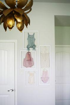 Heirloom clothing framed beautifully as nursery art.