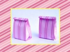 Easy to fold origami gift bag. I used a pink paper, but all kinds of paper are fine. Use a large piece of wrapping paper to make a bigger gift bag. You can f...