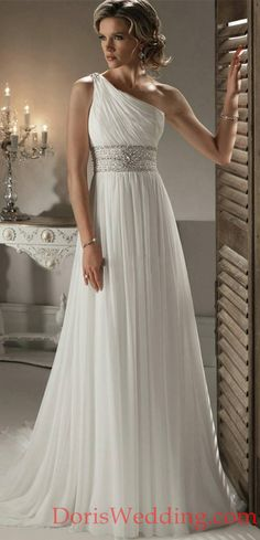This elegant wedding dress harkens back to the Grecian, Roman era. An empire waist fit compliments a one-shoulder style, creating a stunning combination. A sparkling belt adorns the waist, only adding to the overall elegance of the look. The back is complete with a lace up corset style that creates length and looks sexy. A long train finishes the look nicely, making it more formal. This wedding dress is perfect for a bride the loves understated elegance. #DorisWedding #wedding #dress #styles