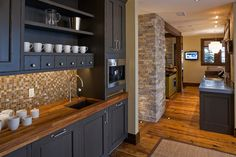 really like the warmth of the wood counter top for morning bar in master. also like the cabinets.