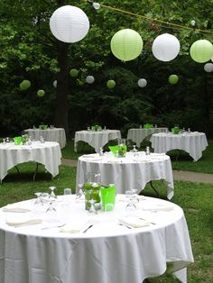Great idea for outdoor wedding lighting - the white and green lanterns play off the table theme and lime centerpieces. Wedding at Lake Keomah State Park near Oskaloosa, Iowa.