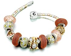 the copper tones mixed with warm golden hues create such a beautiful #chamilia style bracelet.