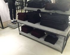 """Macy's Herald Square in Manhattan. Display tables w/blackened steel bases and hand-troweled concrete tops - 1/8"""" reveal all around. From eight-foot long tables to 18""""x18"""" mannequin stands."""