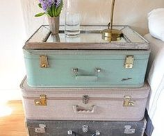 i love old suitcases.  what a cute idea for storage in a small apartment too!
