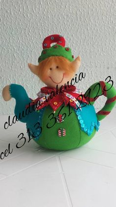 DE ESTA TETERA SALE UN DUENDE. HECHO CON PAÑO LENCY O FIELTRO Christmas Elf, Christmas Crafts, Christmas Decorations, Christmas Ornaments, Holiday Decor, Christmas Sewing, Christmas Fabric, Cute Crafts, Diy And Crafts