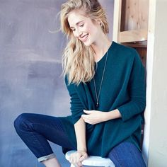 Skinny denim + oversized slouchy sweater + long gold pendant = our fall uniform