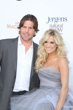 Carrie Underwood and her husband. God bless hockey players