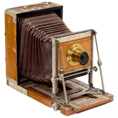 """Tourist Camera by Mackenstein, c. 1895 H. Mackenstein, Paris. Professional field camera, plate size 13 x 18 cm, body no. 845, tropical wood with nickel fittings, light-brown bellows, solid construction, unmarked brass lens with rotating stop, focusing screen back. – Rare Mackenstein """"Tourist"""" version!"""
