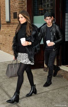 Pin for Later: Can't-Miss Celebrity Pics!  Nick Jonas let his girlfriend, Olivia Culpo, take the lead in NYC on Tuesday.