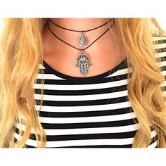 Charm chokers in 4 different styles, the Hamsa Hand, buddha, crescent moon and star, and sun. How to wear charm chokers? You can layer them or wear just one! Love them with a striped shirt! available at ::  www.shop-plume.com