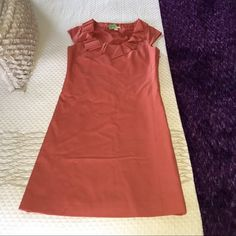 J. Crew coral wool dress Absolutely stunning 100% wool coral dress by J. Crew. My momma always told me to shop out of season to get the best deals, so here's your chance!! Gorgeous collar detail, cap sleeves, side zip. Size 2P. Perfect condition, fully lined! J. Crew Dresses