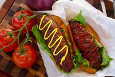 Hamburgers rolled into large hot dog shapes, stuffed with a cheese stick and cooked on…