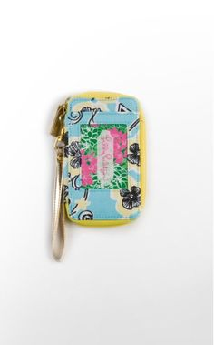 """Lilly Pulitzer Carded ID Wristlet Kappa Alpha Theta. One and done. This is all you need when you leave your house/apartment/dorm. All things are in check-ID, phone, CASH, and LIP GLOSS! Yes, the most adorable little wallet can do this all for you! Attach your keys to the wristlet and you've got a one stop shop for all things most important in your life, besides people, of course ;).Printed wristlet with pockets for IDs, cards, phone. 5 3/8""""w x 3""""h x 7/8""""d. Refined Cotton Twill."""
